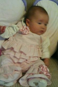 My sweet granddaughter,Kenleigh.first ruffled outfit I made just for her