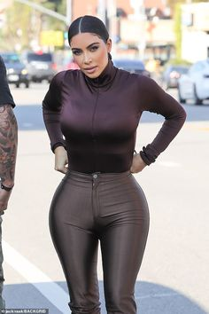 A step back in time: Kim Kardashian flaunted her famously pert bottom in very tight brown disco pants as she met sister Khloe for a shopping trip in Los Angeles on Wednesday Kim Kardashian Blazer, Kim Kardashian App, Kim Kardashian Hollywood Game, Kim Kardashian Snapchat, Kim Kardashian Pregnant, Estilo Kardashian, Kardashian Style, Kim Kardasion, Hollywood Actress Photos