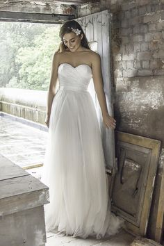 Soft A-line gown with a sweetheart neck line and flowing tulle skirt. <strong>Size: </strong>8 – 30 <strong>Colour: </strong>Ivory <strong>Fabric: </strong>Satin, Tulle, Lace <strong>Style: </strong> A-line <strong>Neckline: </strong>Sweetheart <strong>Laced or Zipped: </strong>Zipped