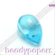 This is for 100 pretty bright aqua blue glass teardrop beads. Approx 9mm by 6mm. These beads have their threading hole across the top of the bead. We have these in black, aqua blue and pink. That took off in such a spectacular way we decided to look for some more unusual beads. | eBay!