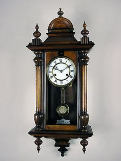 This is a half length German Vienna style wall clock by Erhardt Junghans. Circa: 1890