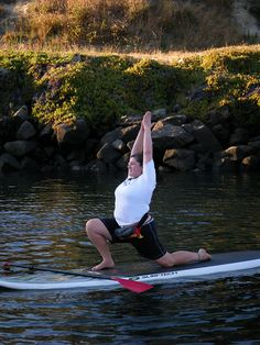 Stand Up Paddleboard Yoga! I love that she has a REAL body!