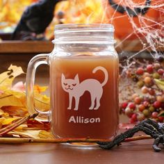 Engraved Halloween Cat Mason Jar So you love Halloween! Get your very own Halloween Personalized Mason jar. This adorable Cat Printed Mug is perfect for this Fun Holiday. Get it personalized as a gift