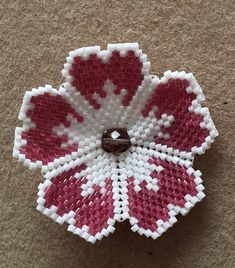 flower brooch of about 4 cm made of Miyuki delicate pearls and swarovski facet and entirely hand-woven Colors: pink and white For more strength lattache silver-colored brooch is glued on a small pieces of suede. Fast and neat delivery in a small -