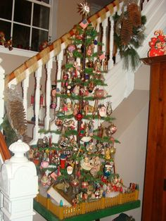 Antique feather tree at stairway from a private collection in Missouri  http://www.hometraditions.com/antique_christmas_in_missouri_s/1952.htm
