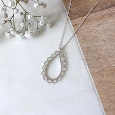 A perfect raindrop finished with perfectly imperfect frills. Available in silver or gold plate Signature scalloped clasp Handmade shape Brushed finish Perfectly Imperfect, No Frills, Necklace Lengths, Pearl Necklace, Im Not Perfect, Handmade Items, Pendants, Pearls, Sterling Silver