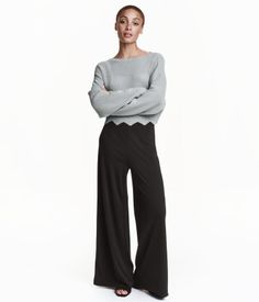 Pants in airy jersey. High waist with concealed zip and button at one side and wide, gently flared legs. Unlined.