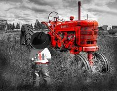 I love John Deere, but any red tractor automatically becomes my fave!  How cute is this photo?!