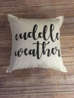"The weather is getting colder which officially makes it ""Cuddle Weather"" season. Doesn't this pillow make you want to cuddle up on the couch and watch TV? Shop for it today at 21 Designs Study!"
