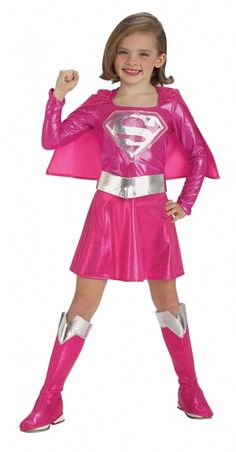 Pink Supergirl Child's Costume - Show that even superheros can have style when you wear this shiny pink metallic Supergirl costume. This super cute dress is a pink metallic stretch knit with a silver Supergirl logo on the front, and an attached cape in the back. The back of the dress has a small Velcro strip where the cape attaches so dressing is easy. #supergirl #calgary #yyc #children #superhero #costume