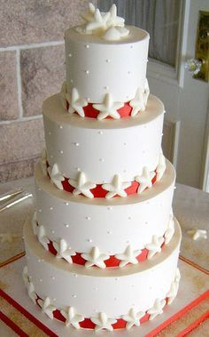 seashell wedding cake with red ribbon - Google Search