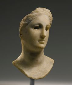 A Hellenistic Marble Head of a Ptolemaic Queen, Circa Mid 3rd/Mid 2nd Century B.C.