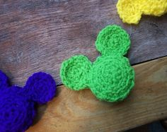 crocheted disney banner.     Wonder how difficult it would be to figure out the mickey heads?