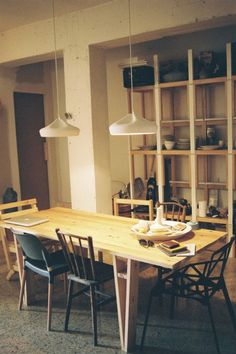 In the home of Xavier Manosa, Ceramist, Studio Apartment, Sant Cugat Poblenou, Barcelona Kitchen Dinning, Dining Room Table, Studio Apartments, Space Furniture, Table Furniture, Kitchen Interior, Kitchen Design, Mismatched Dining Chairs, Archi Design
