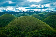 """""""The Chocolate Hills is an unusual geological formation in Bohol, Philippines.It is composed of around 1,268 perfectly cone-shaped hills of about the same size, spread over an area of more than 50 square kilometres (20 sq mi). They are covered in green grass that turns brown during the dry season, hence the name."""""""