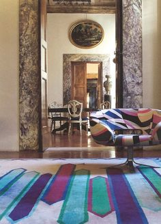 """A view into the offices of the Pucci Company. The chair, """"Rive Droite"""", is made by Cappellini and the rug features the """"Nastri"""" motif."""