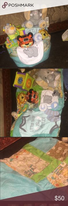 Jungle safari diaper cake Stuff webkinz elephant  Jungle blues greens baby quilt 35x30  Onesie Socks Rattle Tiger bank Lion cold compress Bib Lion rattle  Safari animal box toy Diapers  Wrap in plastic with ribbon Accessories