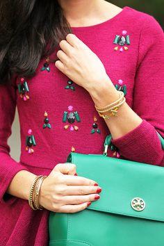 LOVING this kelly green Tory Burch handbag and bejeweled burgundy sweater dress!