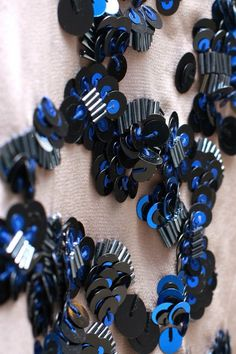 Embellishment-Muse - stacked sequins and bugle beads in trains.