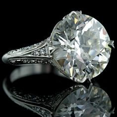 I asked the hubs to buy me this 7.92 carat old cut in a handcrafted mount.  He got a good chuckle out of that.  Hopefully I'll be able to bring him around. Hmmm...