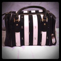 Super fierce striped #L.A.M.B. handbag- I love her handbags and I own this one. It's one of my fav LAMB handbags I have :)