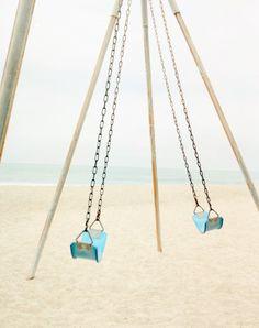 blue swings by the sea.