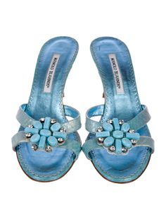 Blue leather Manolo Blahnik slide sandals with embellishments at tops and covered heels.Designer Fit: This style runs narrow and a half size small.