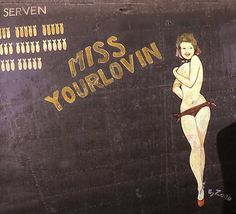 """""""Miss Yourlovin"""" from the Confederate Air Force Collection.  This collection of nose art panels came to the CAF from Minot Pratt, the general manager of the company that was scrapping planes at the boneyard at Walnut Ridge, Arkansas.  He had ordered his men to cut out and save the most interesting nose art, which he was supposedly going to put up as a fence around his property.  This never happened and he donated the pieces to the CAF in the 1960's."""