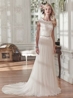 Maggie Sottero Patience Marie.A variation on the strapless Patience dress, with lined neckline & high, lined back.Try it now, at Bellissima Weddings Essex.