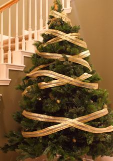 The crisscross method of putting ribbon garland on a Christmas tree