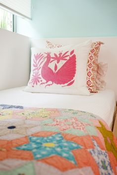 Fun touch with the pink Mexican Suzani pillow!