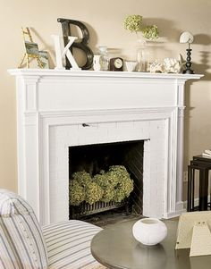 the mantle decor plus hydrangeas (or any flower really) in the fireplace for the spring/summer is genius!Love the mantle decor plus hydrangeas (or any flower really) in the fireplace for the spring/summer is genius! Unused Fireplace, White Fireplace, Fireplace Mantle, Fireplace Design, White Mantle, Fireplace Decorations, Bedroom Fireplace, Modern Fireplace, Empty Fireplace Ideas