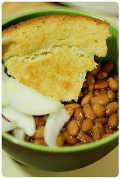 Pinto beans and cornbread with,  sliced onion fresh from the garden.and it is delicious! growing up in Texas, my mom made this often, she added home fried potatoes to this meal.. it was not only good, it was filling and cheap..  :)