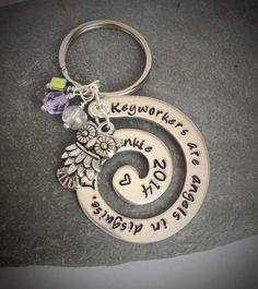 Swirl, fab as a keyring or a necklace. Many different options for text and charms