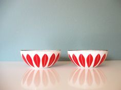 red and white cathrineholm enamel bowls