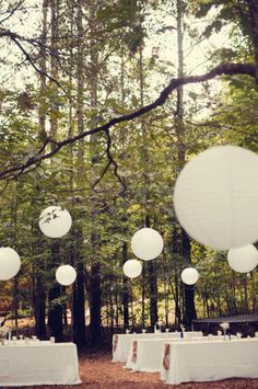 Chinese paper lanterns have become a HUGE hit! They are so simple but add fairy tale flare to your fairy tale wedding.    Items pictured provided by North Georgia Party Rentals - Assembly assistance provided by All Pro Party Consultants
