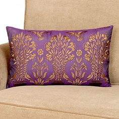 nspired by the rich colors and artful details of the great palaces of India, our Mysterioso Embroidered Topiary Lumbar Pillow makes a luxurious statement in your living room, bedroom or office. Embroidered topiaries and exotic birds in golden yellow stand out against the rich plum Mysterioso background. The reverse side in golden yellow provides stylish contrast for this Lumbar Pillo