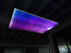 The Northern Lights Art lighting was created with two layers of Dichroic Eco-Resin sandwiching a layer of white fiber optic fabric. Photographed in the Finesilver Art Gallery Complex. #Archinect #Lightlink #Archello #Enlightenmentmag #ZenIndustrial
