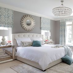 Love the muted colors, sunburst mirror and chandelier. Looks like a very peaceful bedroom