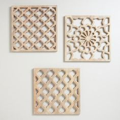 Hung in an entryway, living room or bedroom, our set of three Nathan Carved Wood Wall Panels creates visual and textural interest while adding a splash of Indian flare. Hand-carved by artisans in India using timeworn techniques, the panels resemble delicate lacework with a soft, warm gray finish. Two pieces feature a lattice-like design while the third shows off a floral pattern. Display them in a clean row or line, or in a clever cluster.
