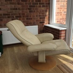 LEATHER RECLINING SWIVEL CHAIR for sale