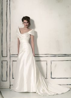 Absolutely gorgeous Justin Alexander wedding dresses style 8560 Portrait collar (detachable) silk dupion, sweetheart ruched A-line, buttons over the back zipper, chapel length train.