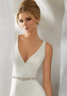 Wednesday, August 30, 2017 Walk with the Understated Glamor of a Vintage Film Star.  Walk with the understated glamor of a vintage film star when you choose this classic satin V-neck gown. The Mori Lee Morena wedding dress has a cinched waist and daring neckline has just the right combination of coverage and bare …