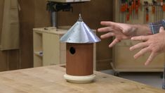 "When I think of woodworking, the first thought is usually building a birdhouse in the garage with a parent or grandparent over a weekend. Most of the time it's not much more than a box with a roof and a hole in the front, but this birdhouse design cuts all the corners. Plus, when you get this project done, you just might want it to hang a-""round"" for a while."
