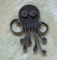 Recycled Felted Wool Sweater/ Zipper Brooch/Pin- Gray Octopus with Silver Zipper. $26.00, via Etsy.