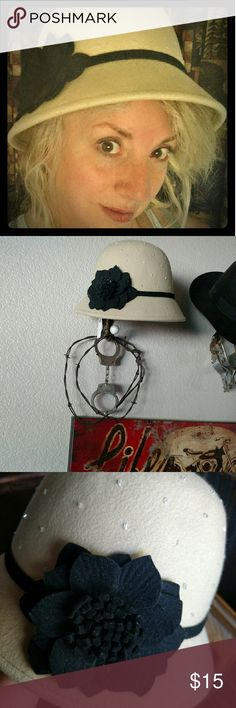"""Cloche hat 100% wool stylish cloche hat with black flower. Never worn except for photo. Has nice individually sewn on sparkle beads. Beautifully lined. NWT. My head circumference is 21 1/4"""" and this fits just a little loose on me with all my hair. Charming Charlie Accessories Hats"""