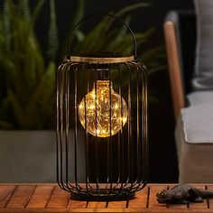 LED Solar Black Outdoor Firefly Bulb Metal Lantern | Dunelm Metal Lanterns, Outdoor Solar Lanterns, Patio Plans, Solar Panels, Garden Inspiration, Outdoor Lighting, Light Up, Bulb, Led