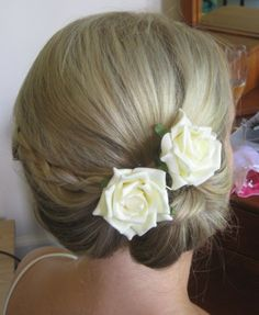 Bridesmaids Updo. Hair with plaits. Low bun worn to the side.