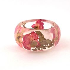 Pink and Yellow Roses in a Chunky Resin Bangle.  Pressed Roses Bangle Bracelet.  Real Flowers - Pressed Rosebuds.  Handmade Resin Jewelry. $44.00, via Etsy.