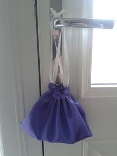 Sewing - Lilac satin gift bag. First item.  Satin is very slippy on the machine so tissue was used to help the tread grip.